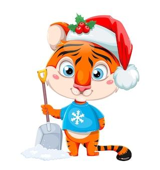 Buon natale simpatico personaggio dei cartoni animati tigre con cappello da babbo natale che tiene in mano una pala da neve