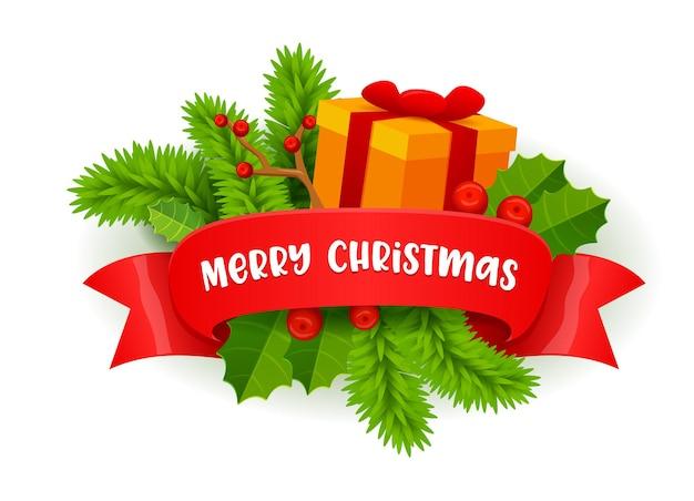 Decorazione festiva di buon natale con rami di abete, bacche di agrifoglio e confezione regalo avvolta con nastro rosso con tipografia.