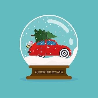 Sfera di vetro di buon natale con auto e albero di natale.