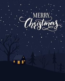 Cartolina d'auguri di buon natale con piccola casa nella foresta. scenario notturno con neve che cade e calligrafia a pennello.
