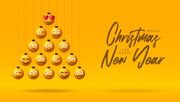 Buon natale e haooy anno nuovo scritte con emoticon gialle su giocattoli a bolle a forma di albero di natale.