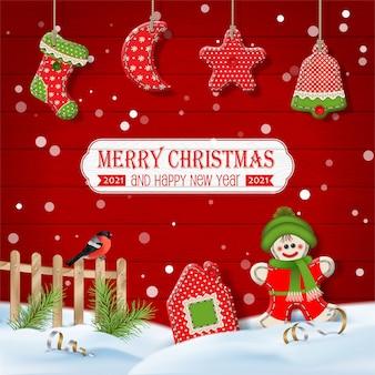 Banner di buon natale e felice anno nuovo con giocattoli tessili