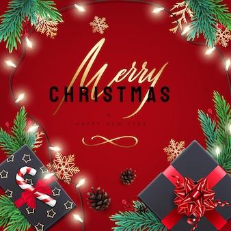 Carta di buon natale e felice anno nuovo con regali e scritte. sfondo rosso con decorazioni natalizie realistiche