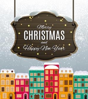 Buon natale e felice anno nuovo card con little town in stile retrò.