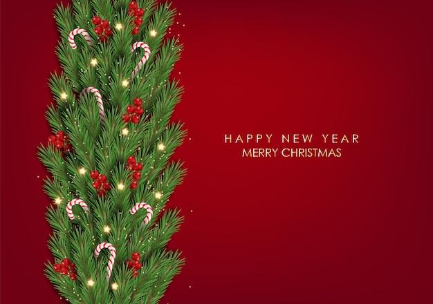 Buon natale e felice anno nuovo, ramo di abete con caramelle di natale