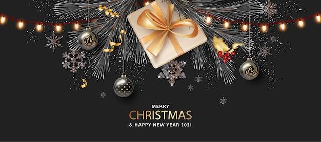 Banner realistico di buon natale e felice anno nuovo con confezione regalo e luci di natale