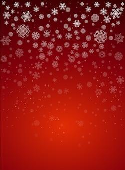 Buon natale e felice anno nuovo con sfondo rosso e neve caduta