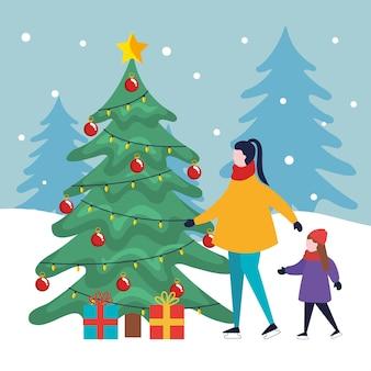 Buon natale madre e figlia con pino e regali