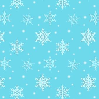Buon natale. reticolo del fiocco di neve su una priorità bassa blu
