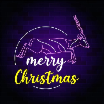 Insegna al neon del testo di buon natale con i cervi di salto