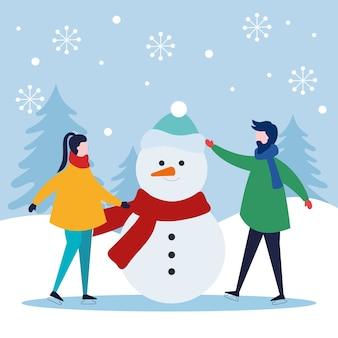 Buon natale donna e uomo con pupazzo di neve