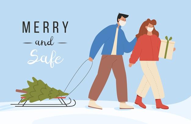 Allegro e sicuro. la giovane coppia moderna trasporta l'albero di natale