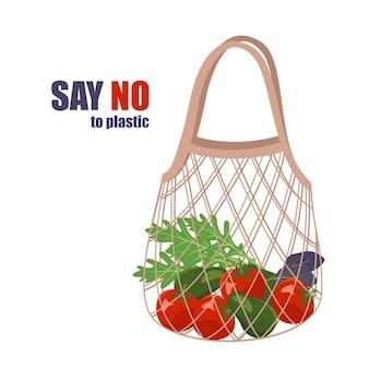 Maglia con verdure cibo sano nella borsa spesa di prodotti biologici dire no allo spreco di plastica...