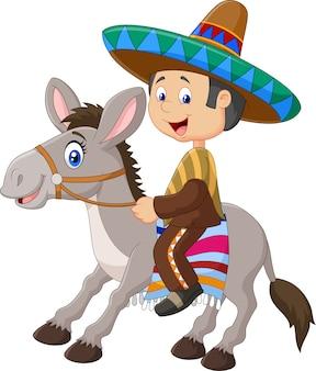 Uomini messicani che guidano un asino