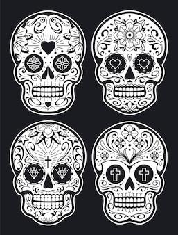 Teschi messicani con motivi. teschi di zucchero in stile tatuaggio old school. versione bianco su nero. accumulazione dei teschi di vettore.