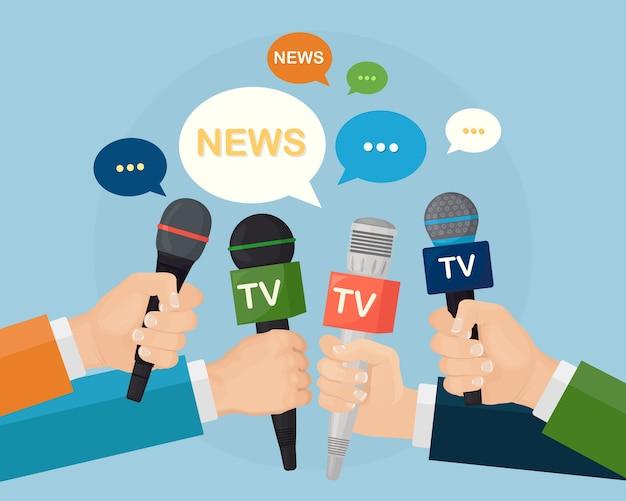Microfoni nelle mani dei giornalisti