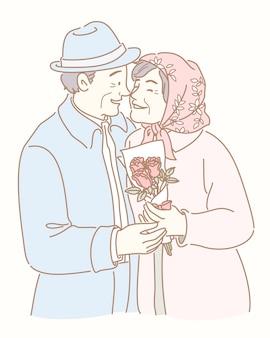 Le coppie di mezza età hanno una data e tenendo l'illustrazione del mazzo di rose