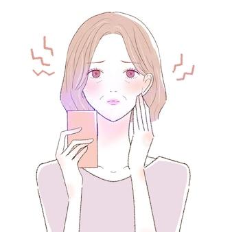 Una donna di mezza età che soffre di affaticamento degli occhi e perdita della vista a causa della luce blu sul suo smartphone. su uno sfondo bianco.