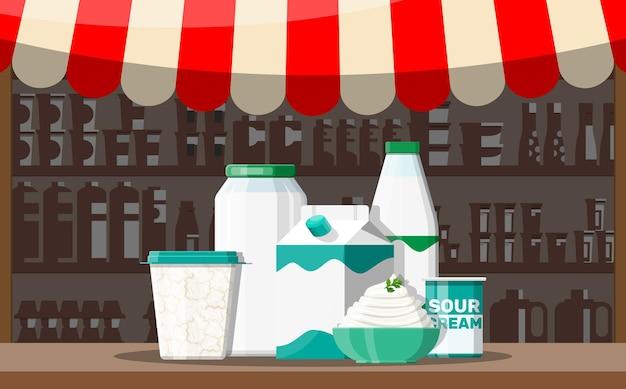 Bancarella del negozio del mercato di strada del latte. negozio contadino o banco vetrina.