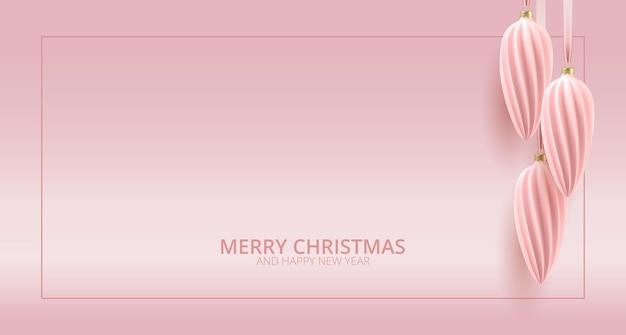 Sfondo di rosa d'oro di natale minimo con palla di natale decorativa e auguri