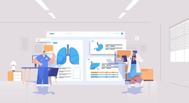 Mescolare il team di medici di razza che impara gli organi dei pazienti analizzando i dati medici sulla scheda virtuale medicina assistenza sanitaria