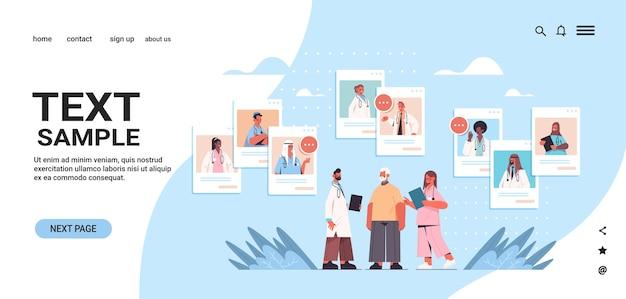 Mescolare i medici di razza nelle finestre del browser web che consultano lo spazio della copia della copia della medicina dell'assistenza sanitaria del paziente maschio anziano consultazione medica online