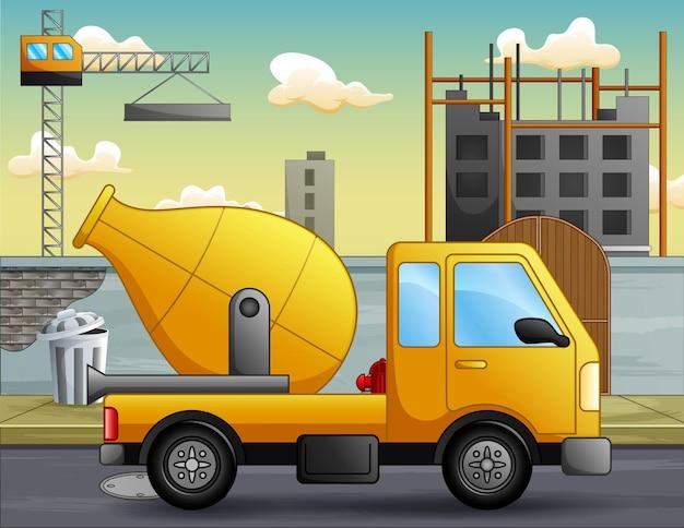 Un camion della betoniera davanti all'illustrazione del cantiere