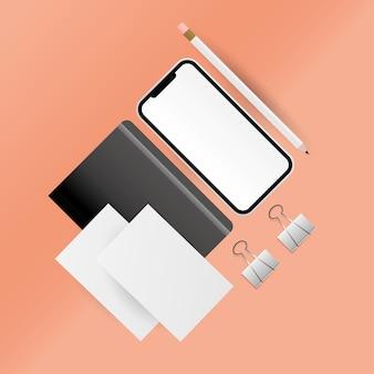 Mockup smartphone matita e design del taccuino del modello di identità aziendale e del tema del marchio