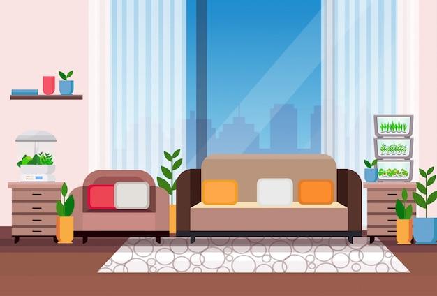 Interno moderno del salone dell'appartamento con le piante domestiche elettroniche domestiche del contenitore di vetro del terrario che coltivano orizzontale piano di concetto