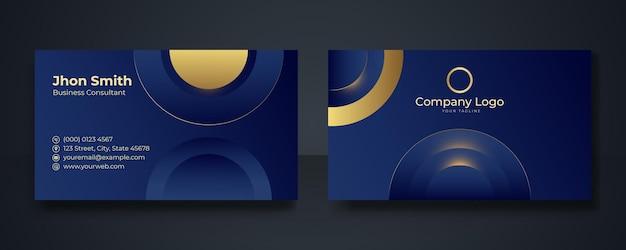Modello di progettazione moderna del biglietto da visita. modello di biglietto da visita professionale pulito, biglietto da visita, modello di biglietto da visita. elementi astratti in oro su sfondo blu scuro.