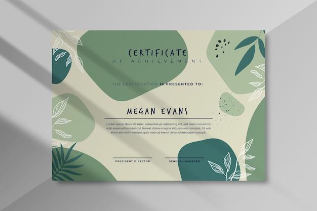 Modello di certificato moderno con foglie