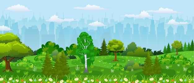Vista sulla città moderna. parco cittadino con alberi e fiori, cielo e nuvole.