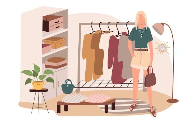 Interni moderni e confortevoli del concetto di web della stanza del guardaroba. la donna sta nella stanza con vestiti, vestiti appesi, pianta,