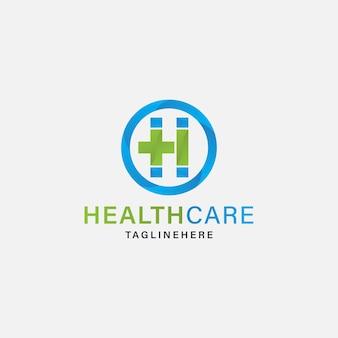 Simbolo della croce medica verde moderna lettera h logo vector illustration