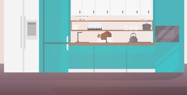 Gli interni della cucina moderna non svuotano la stanza della casa della gente con l'arredamento orizzontale