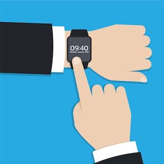 Smartwatch moderno o dispositivo indossabile sulla mano dell'uomo d'affari
