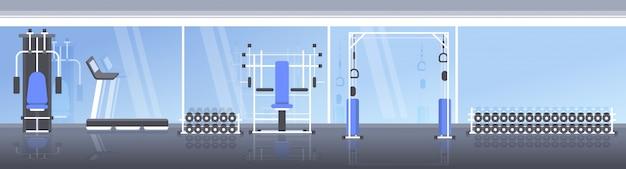 L'interno moderno della palestra di sport non svuota il club di salute della gente con l'insegna orizzontale di concetto sano di stile di vita dell'apparecchiatura di addestramento dell'attrezzatura di allenamento