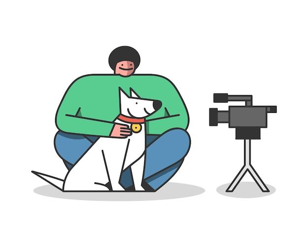 Vlogger moderno che crea video con cane per canale blogger utilizzando una fotocamera moderna
