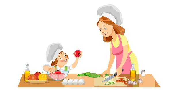 Ragazza del bambino e della mamma che prepara cibo sano a casa