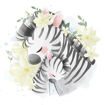Mamma e cucciolo di zebra si abbracciano