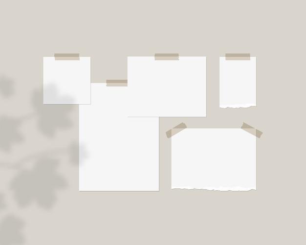 Modello di mood board. fogli vuoti di carta bianca sul muro con sovrapposizione di ombre.