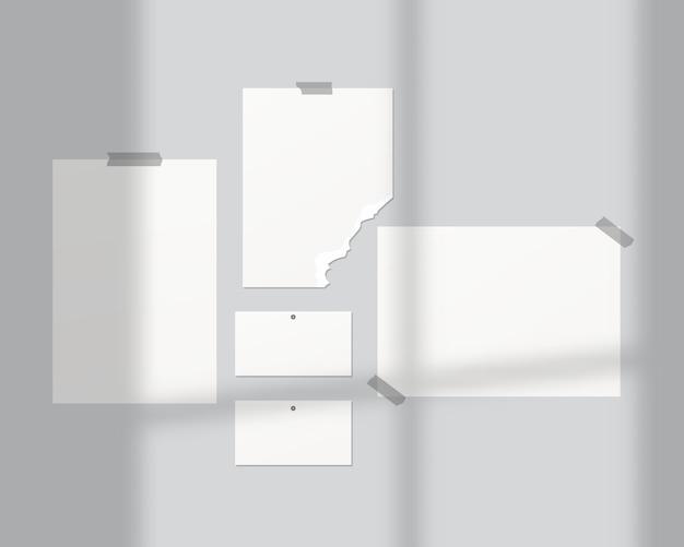 Tavole d'umore . fogli vuoti di carta bianca sul muro. mood board con sovrapposizione di ombre. . modello di progettazione. illustrazione realistica di vettore