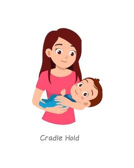 Madre che tiene in braccio il bambino con una posa chiamata culla stretta