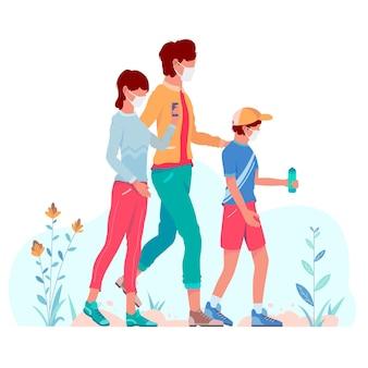 Madre che cammina con i bambini con le maschere mediche all'aperto