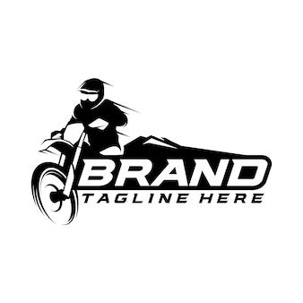 Concetto di logo monocromatico di motocross Vettore Premium