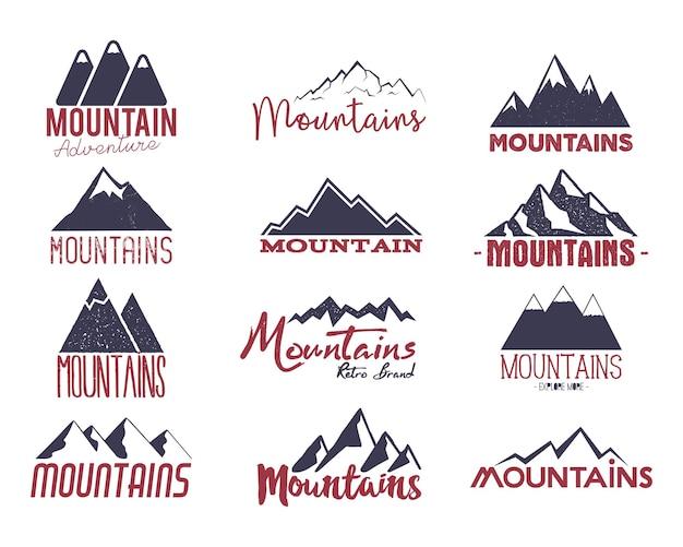 Set di emblemi di montagna. loghi di avventura disegnati a mano vintage. collezione di etichette da campeggio. patch vettoriali stock isolati su sfondo bianco.