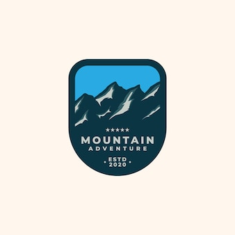 Modello di logo emblema di ghiaccio di montagna.