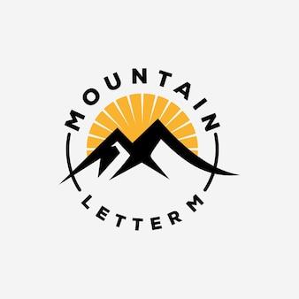 Disegno del logo della lettera m di montagna