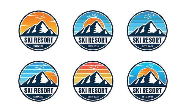 Design del logo di montagna e viaggio