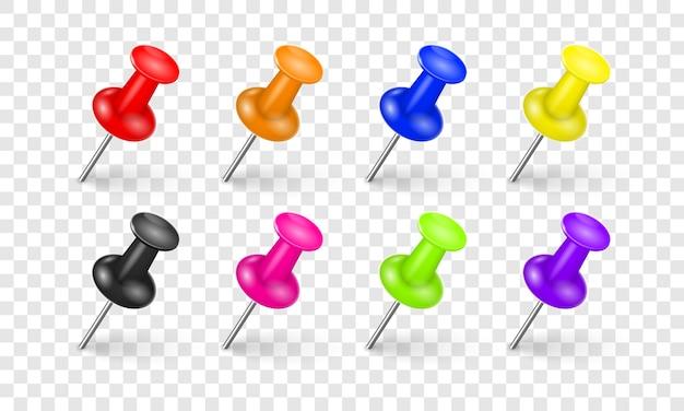 Puntine multicolori con un'ombra realistica su uno sfondo bianco. una collezione di puntine da ufficio colorate lucide, elementi di design in stile 3d.